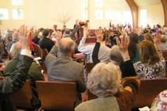 2012-congregation_hands_up