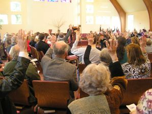 Congregation voting with hands up