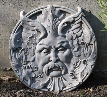 Green Man plaque purchased from CUUPS funds to watch over the UUCS garden. He could also be called Herne the Hunter or Cernuous, a Celtic god of the forest. He is often depicted as the horned god, sometimes with the attributes of a wild stag. 2016-08