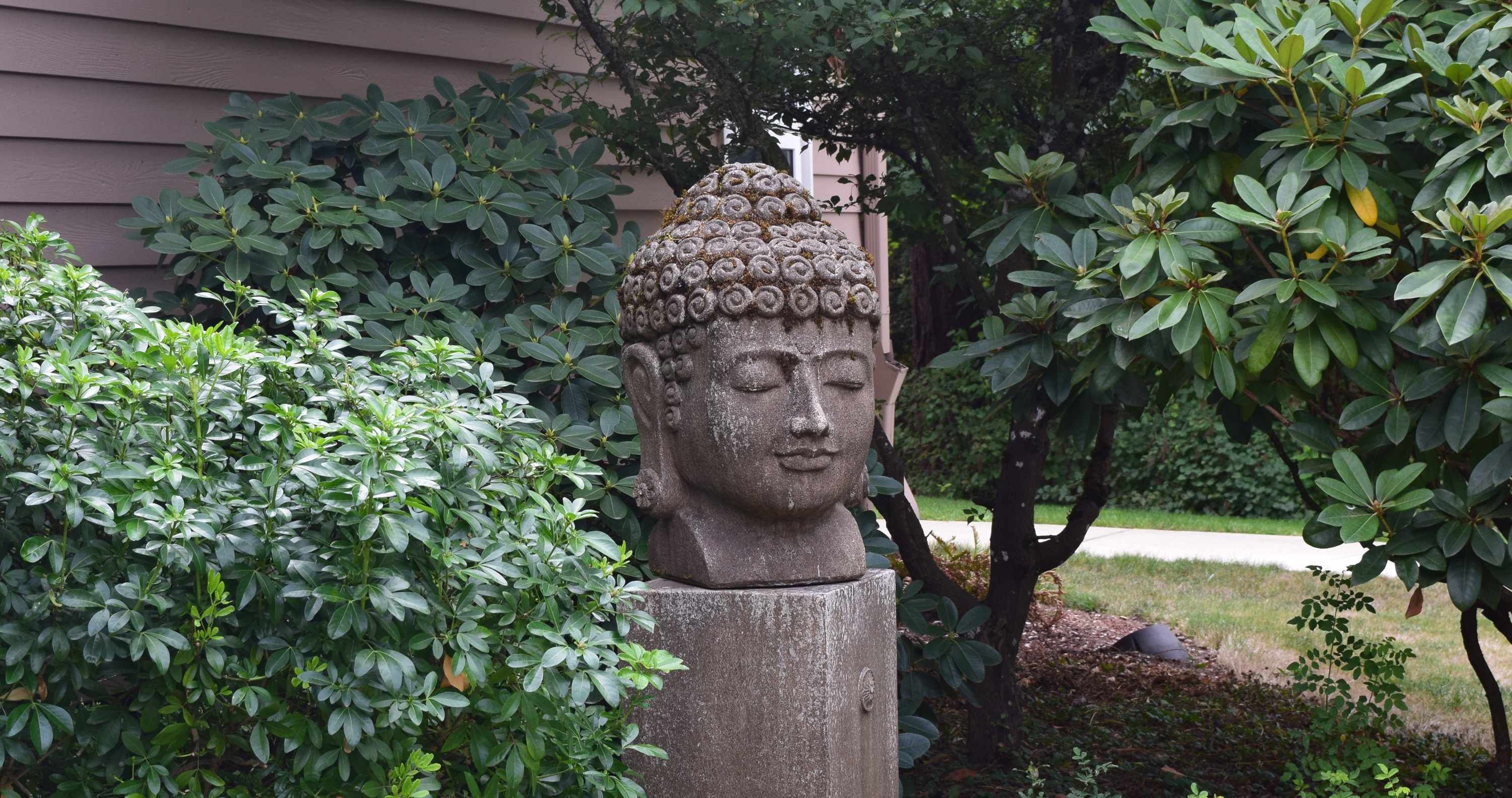 Head of Buddha statue in UUCS garden