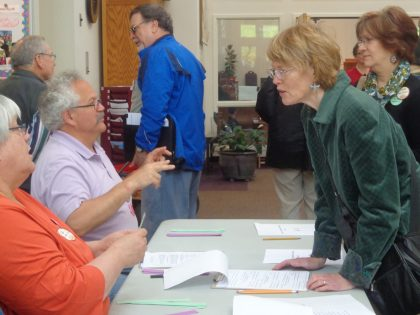 UUCS members check their voting status at tables in the Foyer prior to the annual meeting 2014-5-4