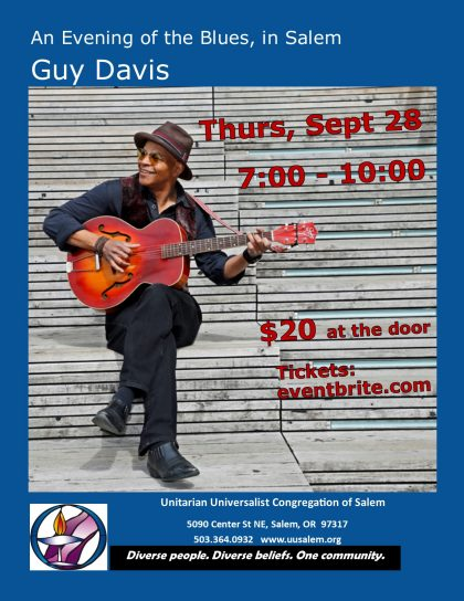 Guy Davis, smiling, holding a red guitar on bleachers with poster info. African-American blues guitarist and more. Concert at UUCS 2017-09-28