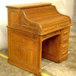 Item 37 - Early American Mahogany Roll Top Desk