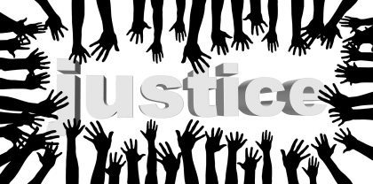 hands reach toward the word justice downloaded from pixabay 2017-10-01