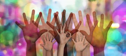 Many hands up on multi colored background, one hand making an OK sign uploaded from pixabay 2017-10-01